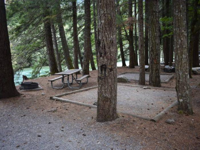 Picnic table, fire ring and tent pad at Gorge Lake Campground site 3.Site 3 at Gorge Lake Campground