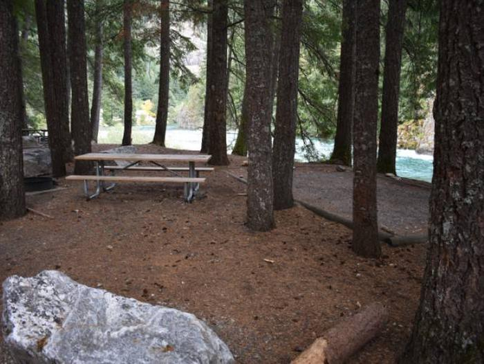 Picnic table, fire ring and tent pad at Gorge Lake Campground site 4.Site 4 at Gorge Lake Campground