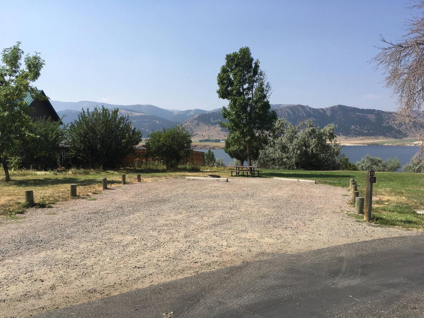 Site 19 BLM Holter Lake Campground. Lakeside campsite. Paved access to campsite. Graveled campsite with picnic table and fire pit. Trees dispersed throughout campground. Adjacent to private land.Site 19 BLM Holter Lake Campground.