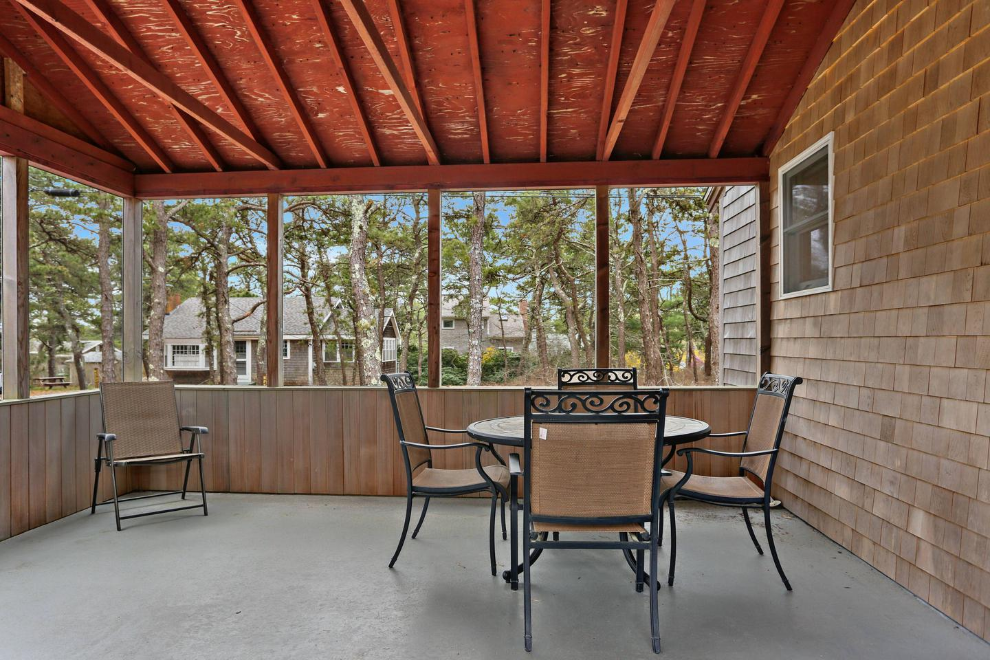A screened porch is always a popular place for relaxing in the morning air