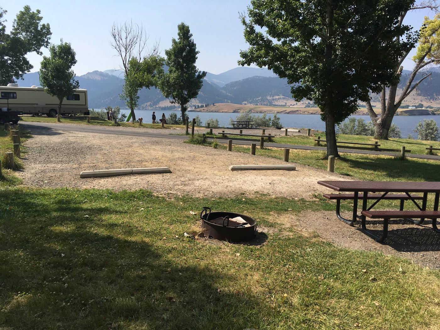 Site 9 is an interior campsite at Holter Lake Campground. Holter Lake is viewable from Site 9. Campsites are in between the lake and Site 9.Site 9 BLM Holter Lake Campground.