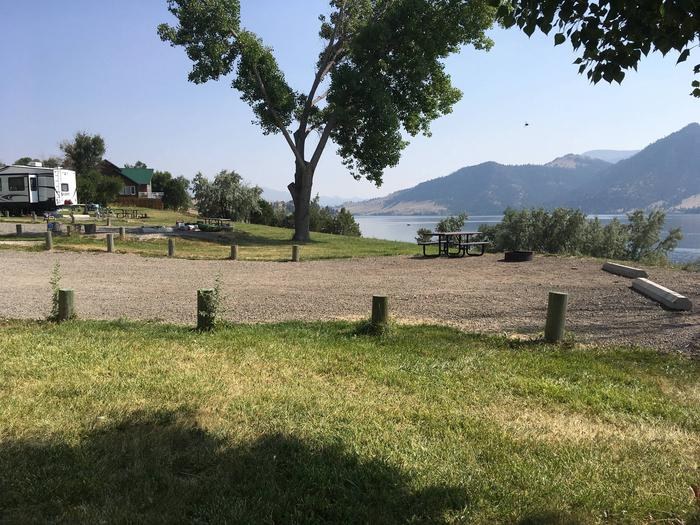 Site 12 BLM Holter Lake Campground. Sideview of campsite with graveled campsite surrounded by wooden posts to keep motorized equipment on graveled surfaces.Site 12 BLM Holter Lake Campground.