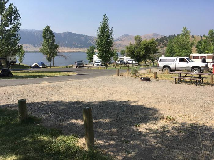 Site 28 BLM Holter Lake Campground. View of Holter Lake. Site is below Beartooth Road. Picnic table and fire pit within campsite.Site 28 BLM Holter Lake Campground.