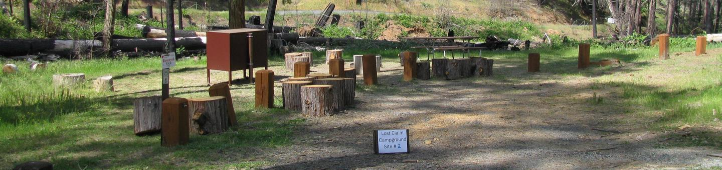 Native surface site with picnic table, fire ring and bear-proof food storage boxLost Claim Campground, Site #2