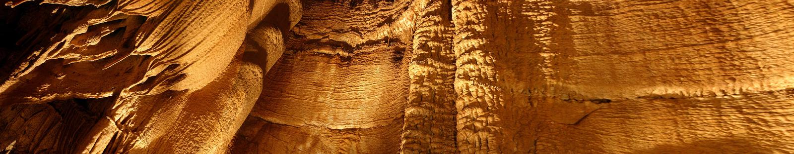 Domes and Dripstones tour, has vast areas of flowstone that resembles draperies. Domes and Dripstones tour