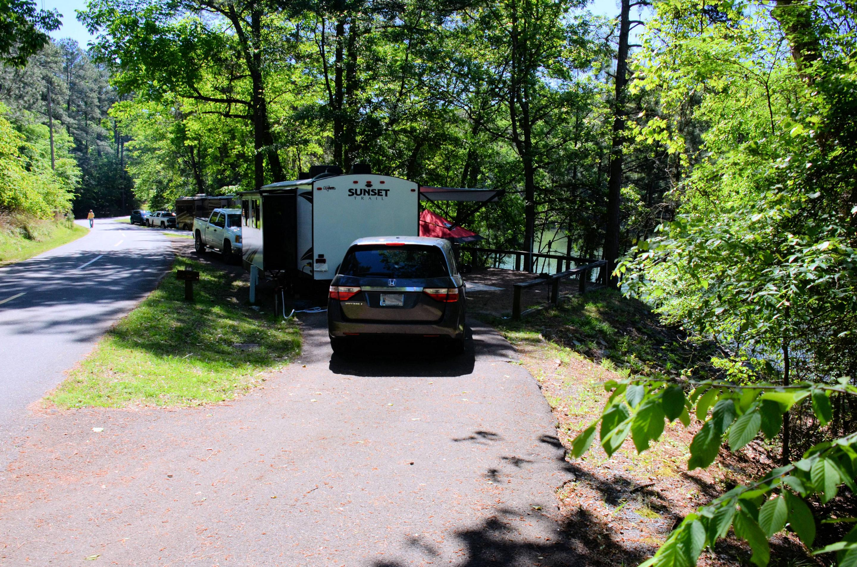 Pull-thru entrance, driveway slope, utilities-side clearance.McKinney Campground, campsite 48.