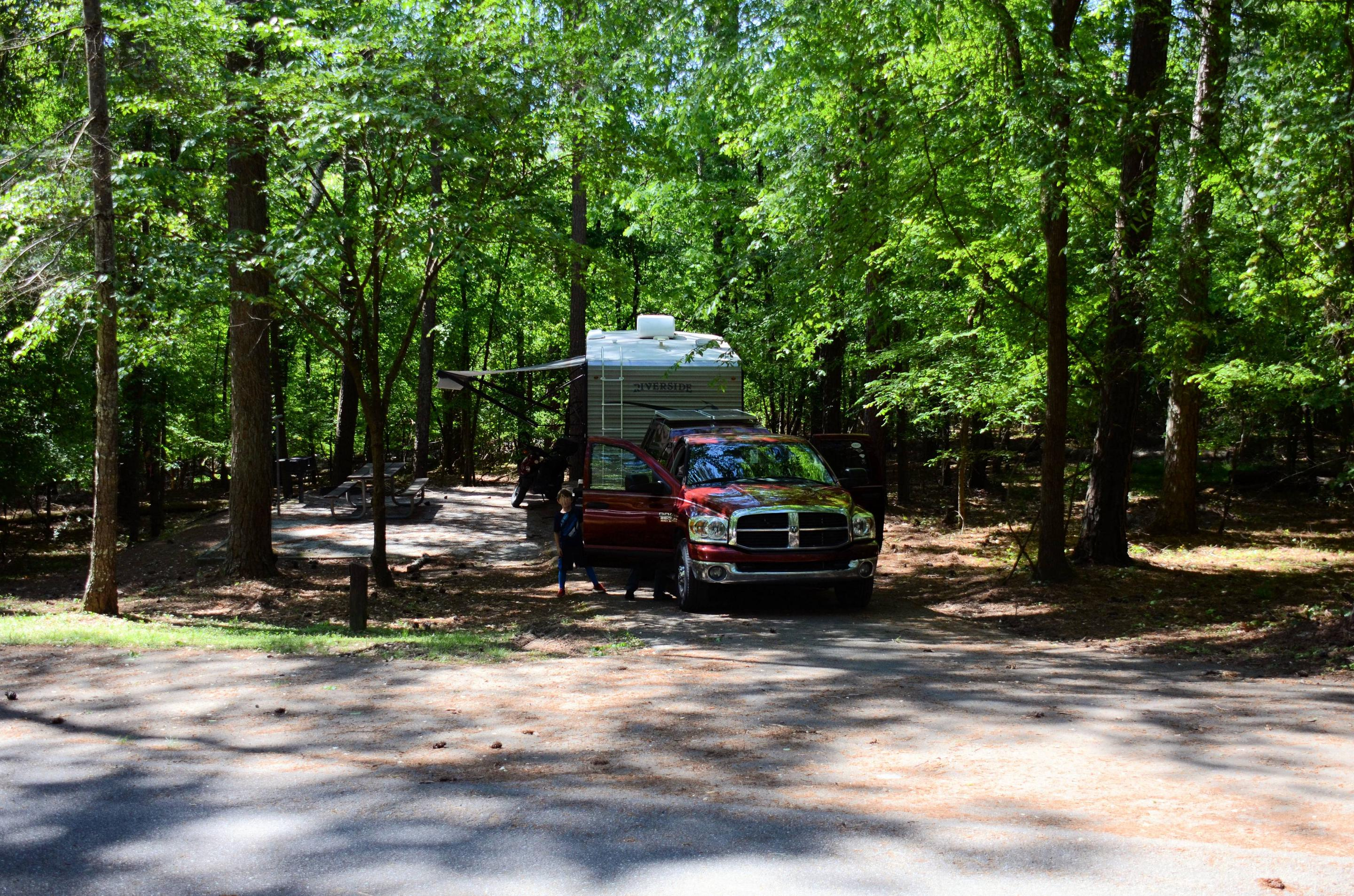 Driveway entrance/slope, awning-side clearance.McKinney Campground, campsite 60.