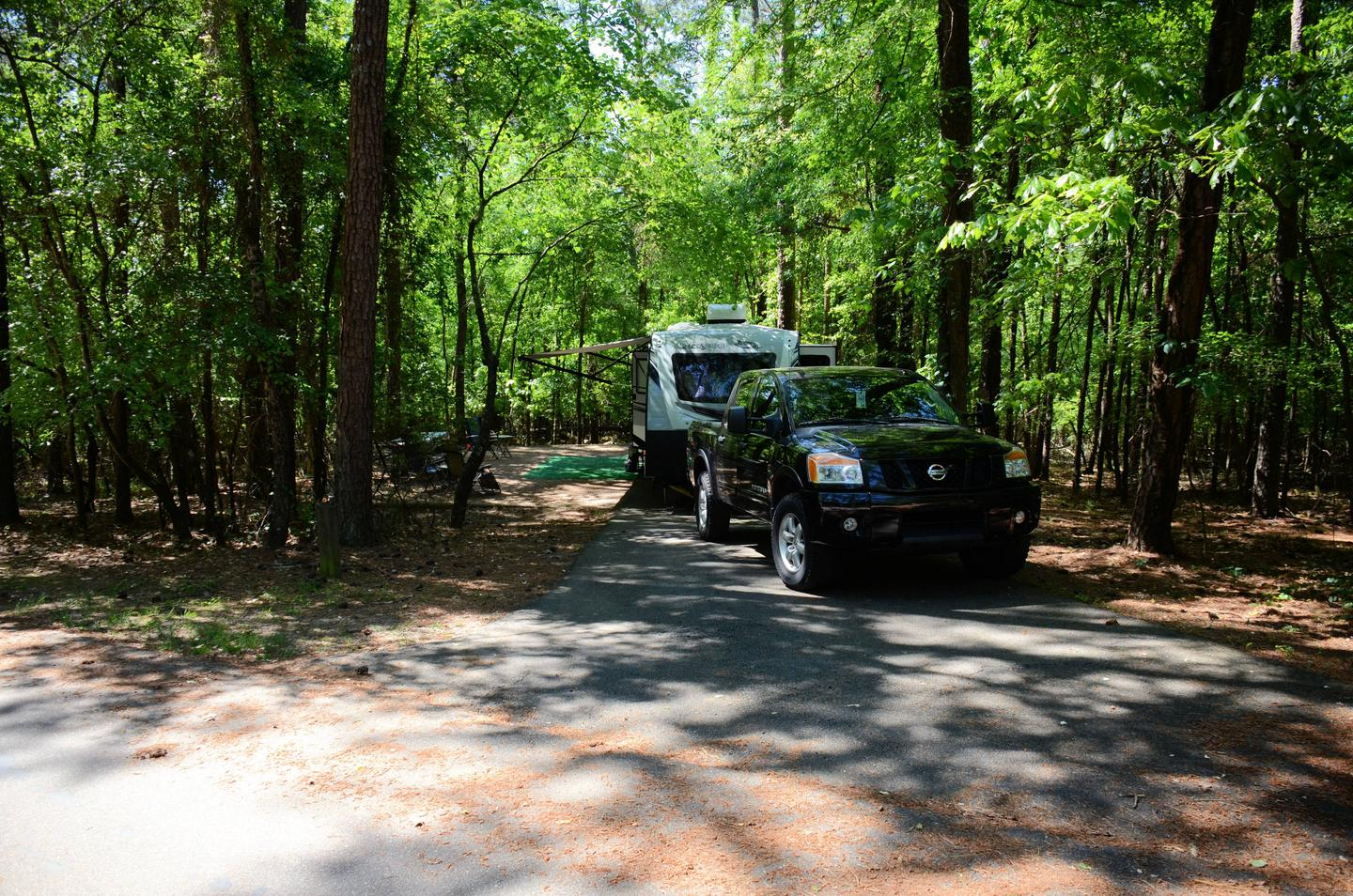 Driveway entrance angle/slope, utilities-side clearance, awning-side clearance.McKinney Campground, campsite 63.