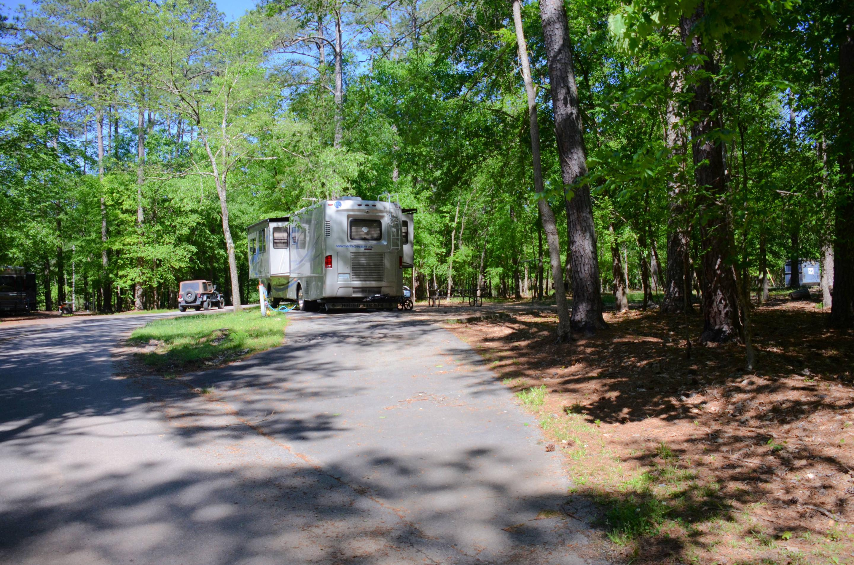 Pull-thru entrance, driveway slope, utilities-side clearance.McKinney Campground, campsite 74.
