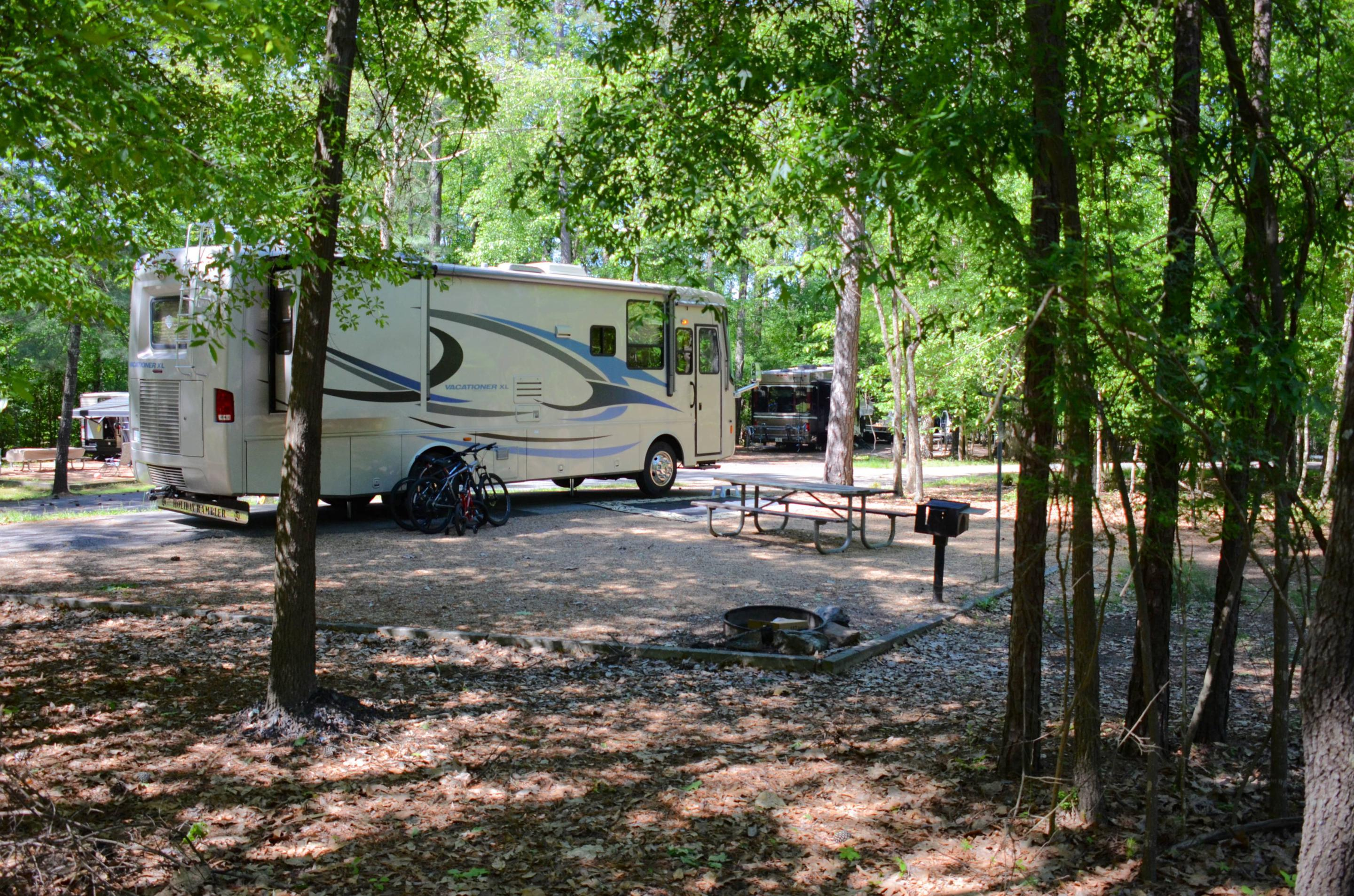 Campsite view, amenities, awning-side clearance.McKinney Campground, campsite 74.