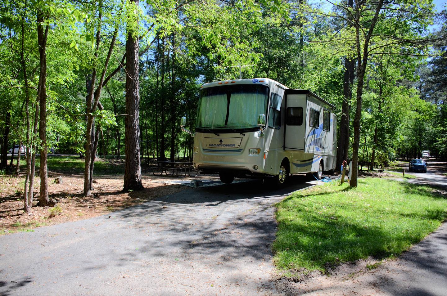 Pull-thru exit, driveway slope, utilities-side clearance.McKinney Campground, campsite 74.