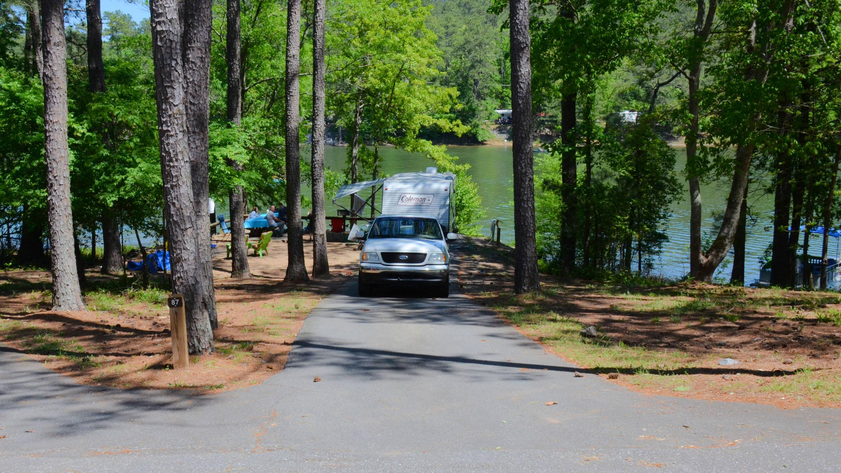 Driveway entrance, slope.  Utilities-side clearance, awning-side clearance.McKinney Campground, campsite 87.