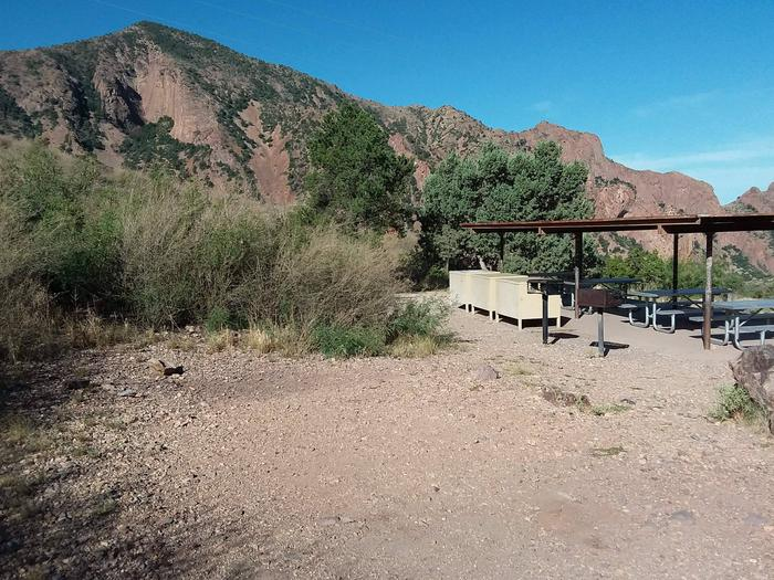 Flat, tent area in front of the shade structure with picnic tables, bear boxes, and grillFlat, tent area in front of shade structure