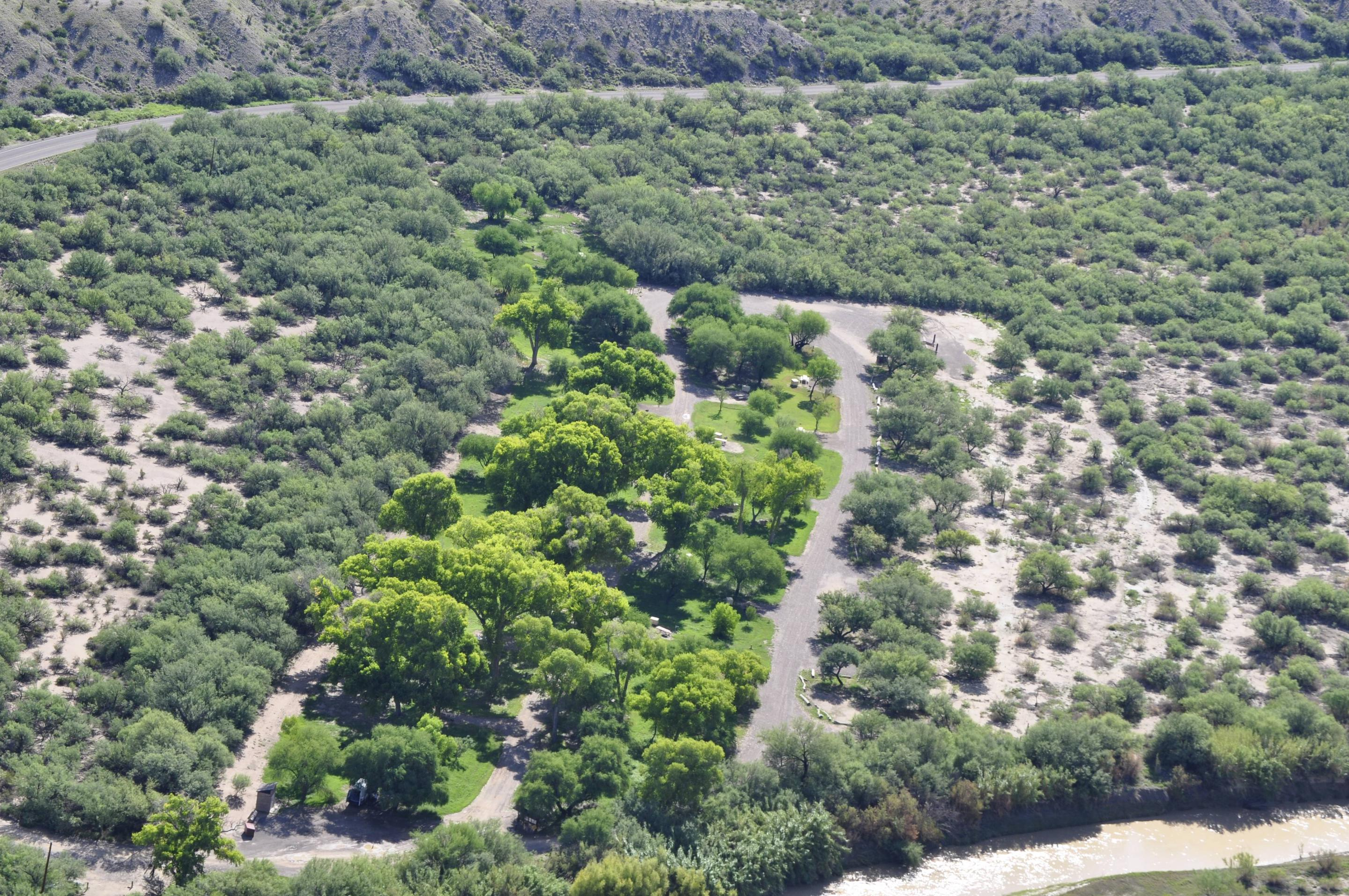 Aerial view of Cottonwood Campground, bright green trees amidst the low desert, riparian areaAerial view of Cottonwood Campground