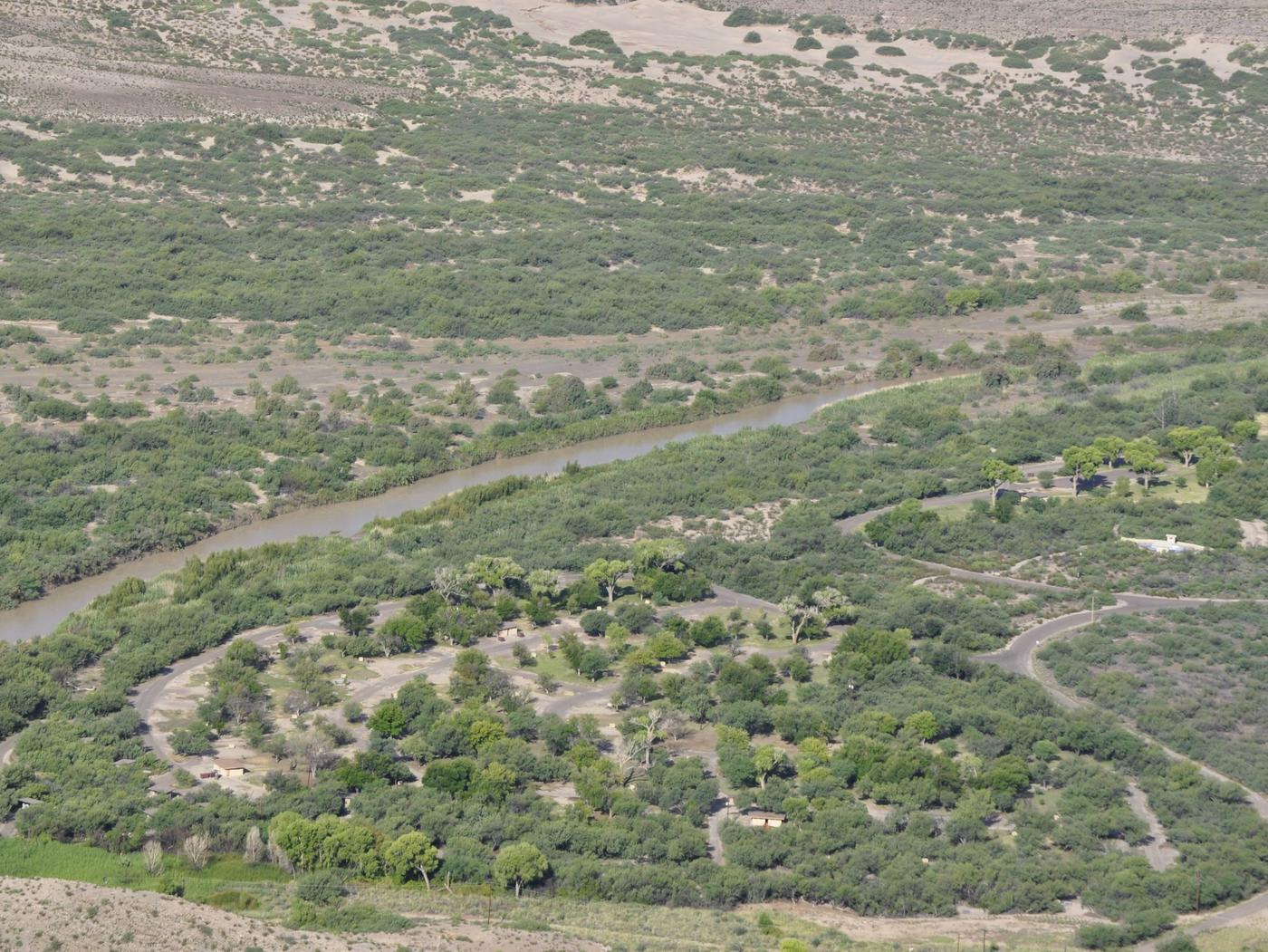 Aerial view of Rio Grande Village Campground, with Rio Grande visible just to the southAerial view of Rio Grande Village. Group campground is rightmost open areas visible.