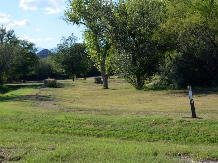 View of wide, grassy path leading from the parking site to the camping areaThis is the walk from the parking site to the camping site. The area is grassy, mostly flat with some sloping areas.