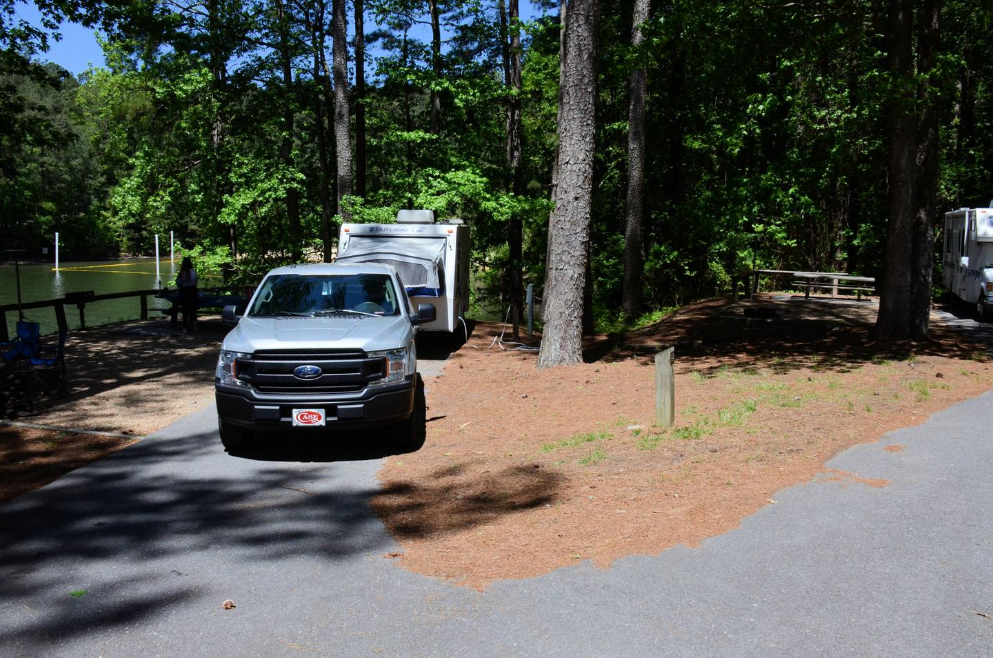 Driveway entrance/slope, utilities-side clearance.McKinney Campground, campsite 122.