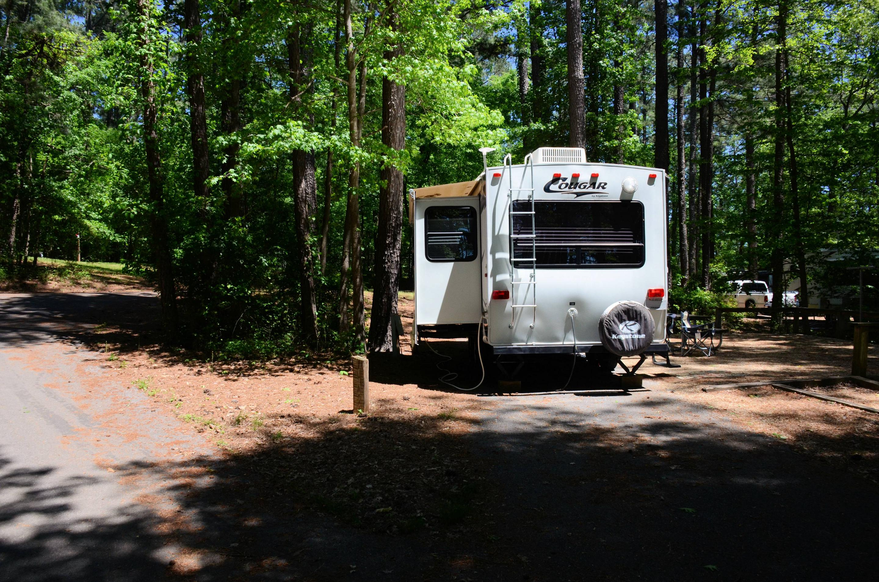 Pull-thru entrance, driveway slope, utilities-side clearance.McKinney Campground, campsite 128.
