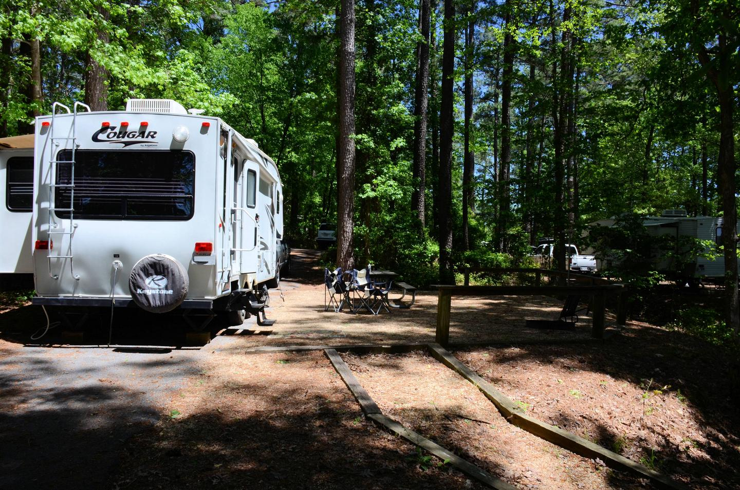 Pull-thru entrance, awning-side clearance.McKinney Campground, campsite 128.