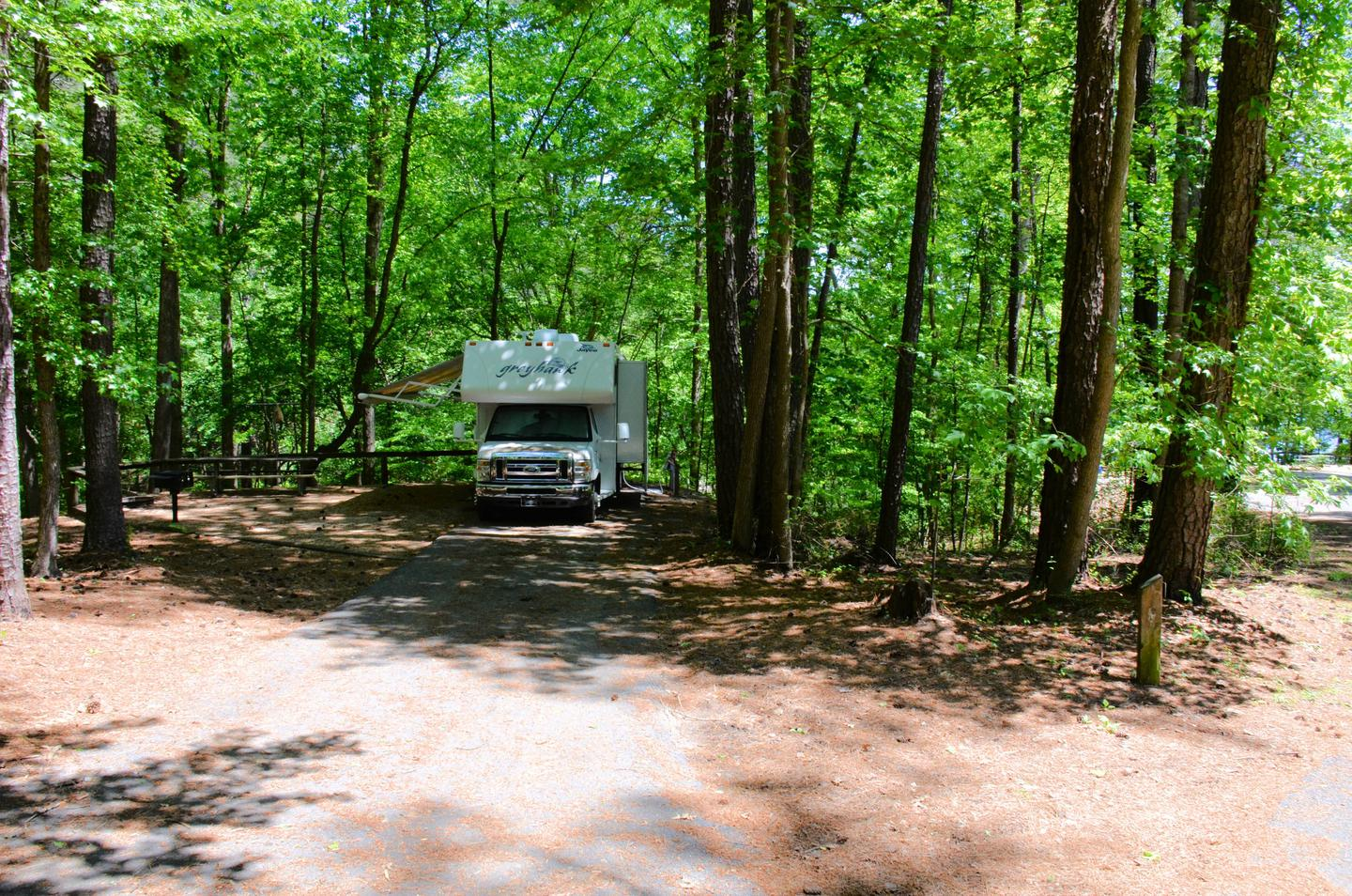 Driveway entrance/slope, utilities-side clearance.McKinney Campground, campsite 136.
