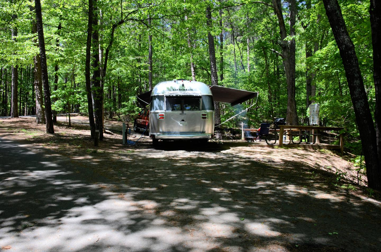 Pull-thru entrance, driveway slope, utilities-side clearance, awning-side clearance.McKinney Campground, campsite 150.