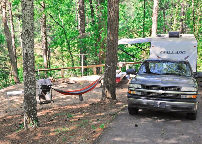 Driveway slope, awning-side clearance, campsite view.Sweetwater Campground, campsite 10.