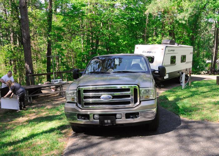 Pull-thru exit, driveway slope, utilities-side clearance.Sweetwater Campground, campsite 11