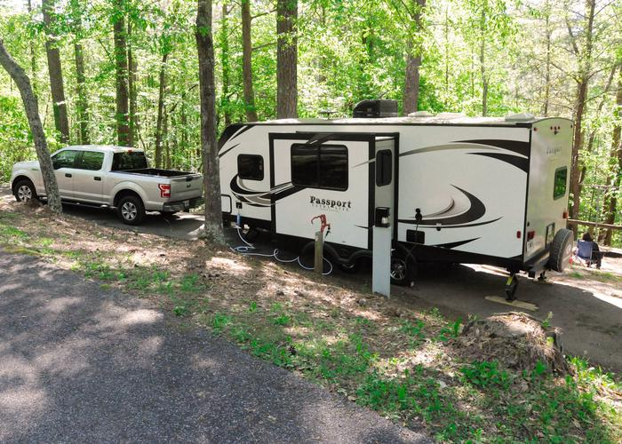 Pull-thru, driveway slope, utilities-side clearance.Sweetwater Campground, campsite 12.