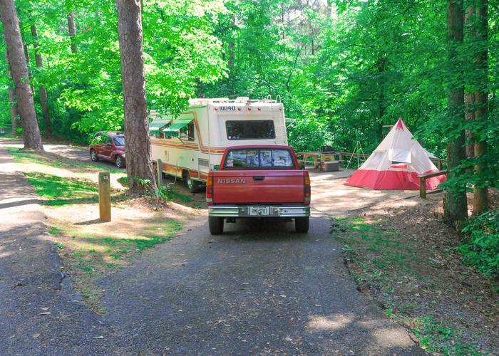 Pull-thru entrance, driveway slope, utilities-side clearance, awning-side clearance.Sweetwater Campground, campsite 13.