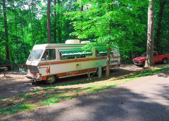 Pull-thru, driveway slope, utilities-side clearance.Sweetwater Campground, campsite 13.