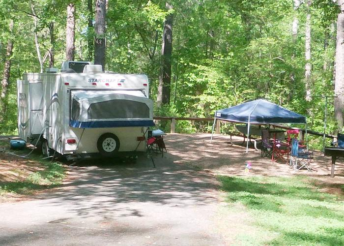 Pull-thru entrance, driveway slope, utilities-side clearance, awning-side clearance.Sweetwater Campground, campsite 16.