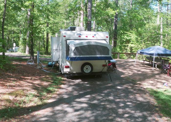 Pull-thru driveway slope, utilities-side clearance, awning-side clearance.Sweetwater Campground, campsite 16.