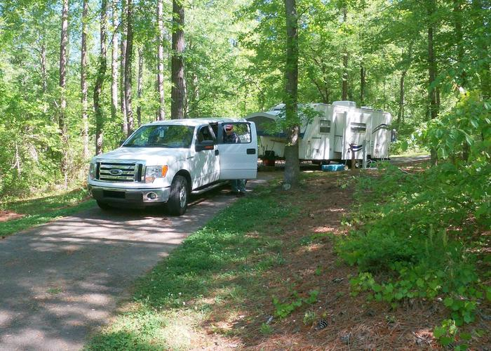 Pull-thru exit, driveway slope, utilities-side clearance.Sweetwater Campground, campsite 16.