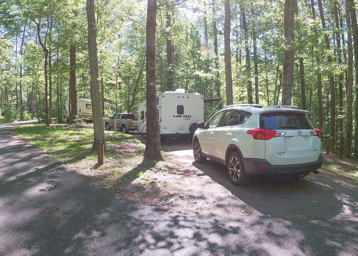 Pull-thru entrance, driveway slope, utilities-side clearance.Sweetwater Campground, campsite 19.