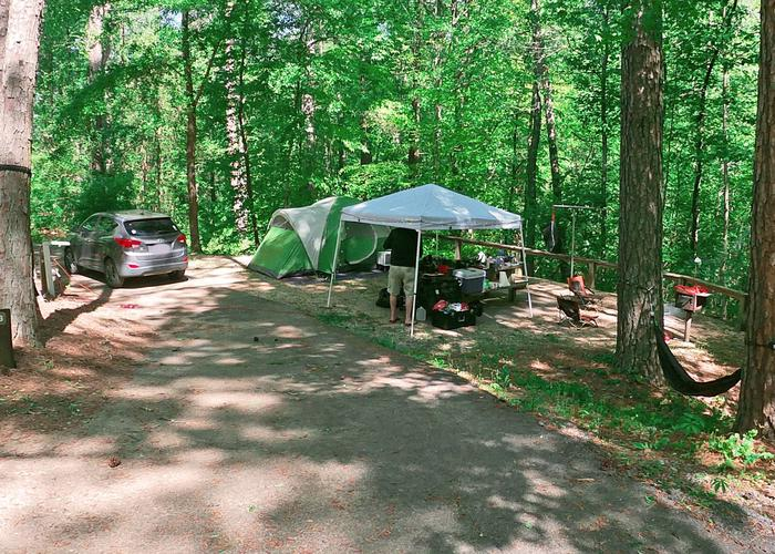 Pull-thru entrance, driveway slope, utilities-side clearance, awning-side clearance.Sweetwater Campground, campsite 23.
