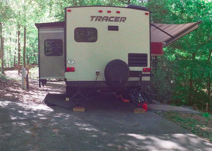 Pull-thru utilities-side clearance, awning-side clearance.Sweetwater Campground, campsite 26.