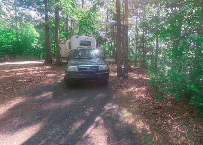 Group Site 28G, pull-thru entrance, driveway slope, utilities-side clearance.Sweetwater Campground, group campsite 28G.
