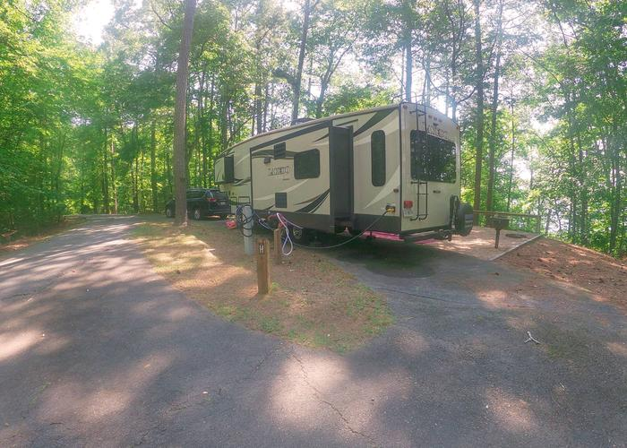 Group Site 28H, pull-thru entrance, utilities-side clearance.Sweetwater Campground, group campsite 28H.