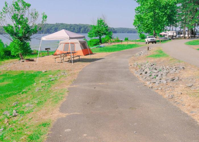 Pull-thru exit (foreground), entrance, utilities & awning clearance.Sweetwater Campground, campsite 49.