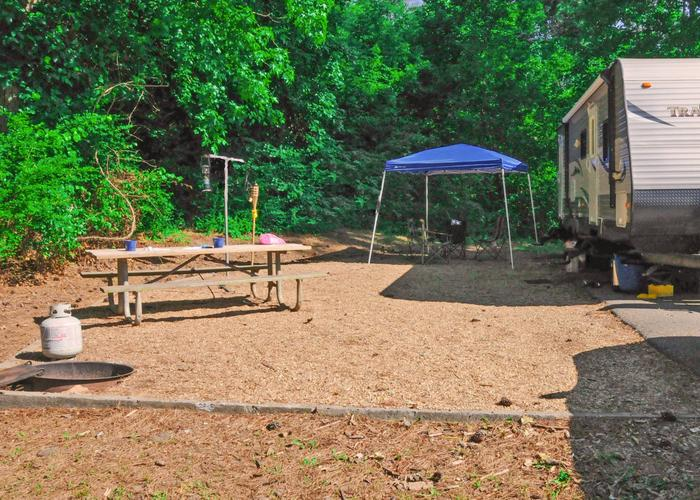 Campsite view, awning-side clearance.Sweetwater Campground, campsite 54.