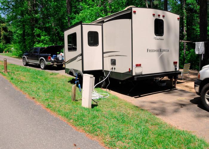 Pull-thru entrance, driveway slope, utilities-side clearance.Sweetwater Campground, campsite 92.
