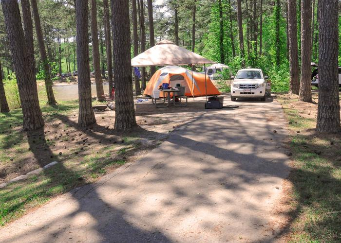 SW101 - Driveway slope, utilities and awning-side clearance, campsite view.Sweetwater Campground, campsite 101.