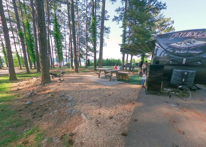 SW111 - Pull-thru exit, awning-side clearance.Sweetwater Campground, campsite 111.