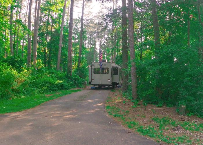 SW126 - Pull-thru entrance, driveway slope.Sweetwater Campground, campsite 126.
