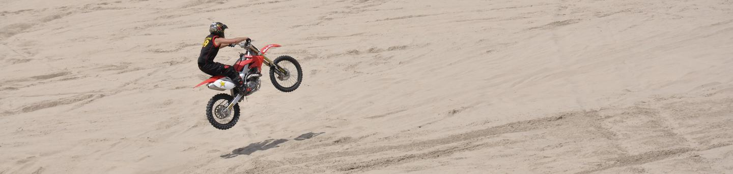 Motorcycle rider at Weiser DunesPhoto of a motorcycle rider in the air after riding up a steep sand dune at Weiser Dunes.