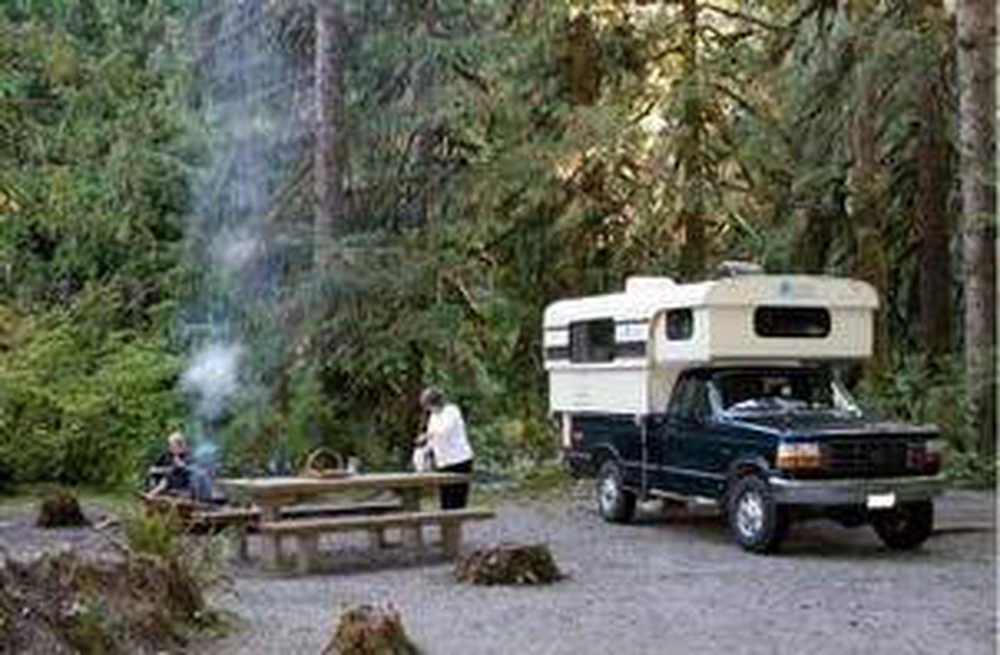 Turlo campsite with picnic table and camperA camper is parked at a campsite in Turlo Campground