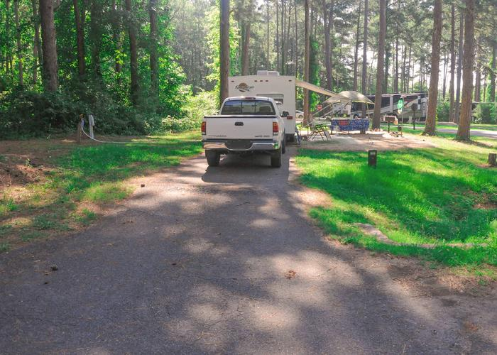 Pull-thru entrance, driveway slope, utilities-side clearance, awning-side clearance.Sweetwater Campground, campsite 105.