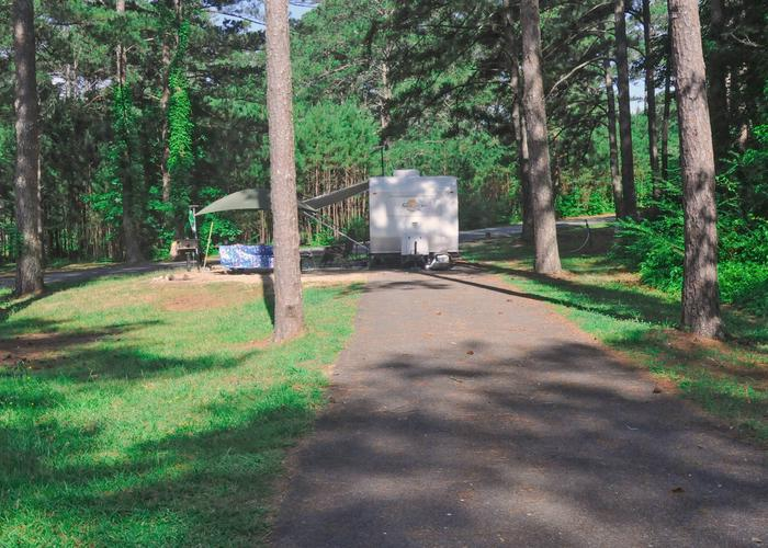 Pull-thru exit, utilities-side clearance, driveway slope.Sweetwater Campground, campsite 105.