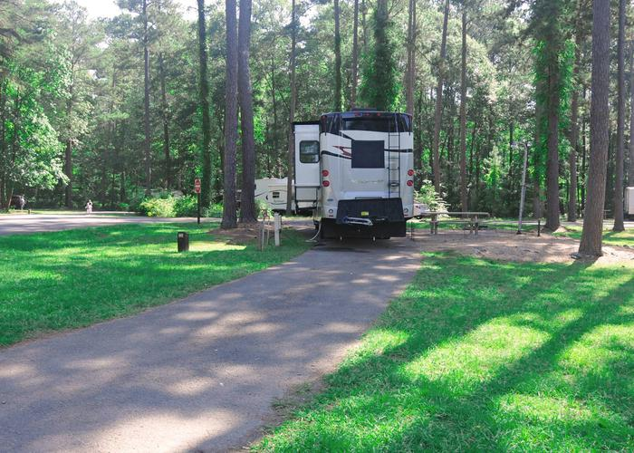 Pull-thru entrance, driveway slope, awning-side clearance, utilities-side clearance.Sweetwater Campground, campsite 107.