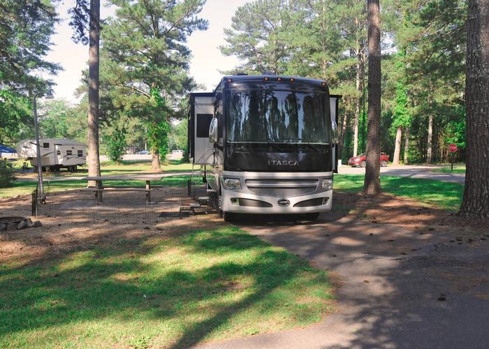 Pull-thru exit, driveway slope, awning-side clearance.Sweetwater Campground, campsite 107.